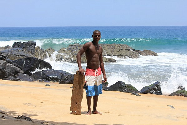 Morris with his wooden boogie board